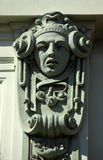 Architectural detail of an old building, Zagreb. Architectural detail with a mascaron of a young woman set on top of a column on the facade of an old building Royalty Free Stock Photography