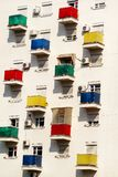 Architectural detail and pattern of modern residential building with colorful balconies and windows of apartments. royalty free stock photo
