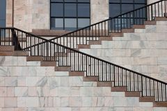 Architectural detail of a stairway. Architectural detail of a marble stairway with handrail Royalty Free Stock Photo