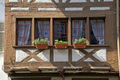 Traditional half-timbered window balcony at old medieval town, S royalty free stock photography