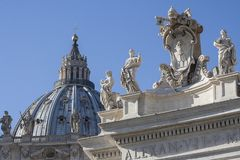 The Vatican City, Rome , Italy - architectural detail of the basilica of the vatican. Architectural detail of Vatican coat of arms against San Pietro Saint Peter stock photo