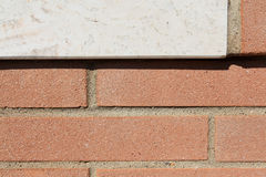 Architectural detail. View of an architectural detail. In the picture you can see the red brick of an external wall of a villa Royalty Free Stock Image