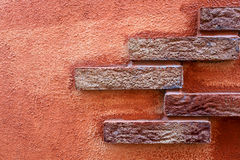 Architectural detail. View of an architectural detail. In the picture you can see the stones and the red wall of a house Royalty Free Illustration