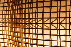 Architectural Detail. Of a wooden structure illuminated by a warm light stock image