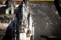 Architectural details of ancient partly destroyed brick pagoda Wat Chedi Luang stock photography