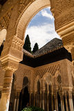 Architectural details of arches and columns decorated. At the historic site of the Alhambra in spain Royalty Free Stock Images