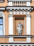 The facade of the building with stucco details in the city of St. Architectural details balconies, pilasters, arches, rosettes, cornices, busts, a statue in a stock images