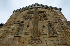 Architectural details on wall of the Gergeti Trinity Church. Tsminda Sameba. stock images