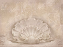 Architectural details. Blank for flyers, messages, business cards, posters, etc. in shabby chic style. Art deco figures carved on. Stone as decoration on a royalty free stock image