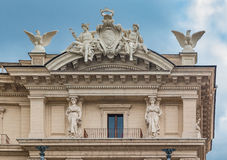 Architectural details of a building in Rome with Olympic Gods Royalty Free Stock Photo
