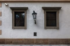 Architectural details. Czech house. Architectural details. The windows of an old Czech house. Plaster and lantern. Details of the facade of the building royalty free stock image