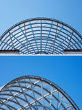 Architectural Details of a Glass and Steel Building. Two details of steel and glass roof of a modern building with blue clear sky stock image