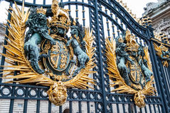 Architectural details, London City Center. Buckingham Palace gate with royal coat of arms, London, UK Royalty Free Stock Images