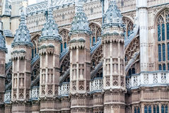 Architectural details, London City Center. Turrets with flags decorate the House of Parliament in London, UK Royalty Free Stock Photo