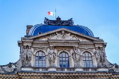 Architectural details of the Louvre Palace with the French flag. Paris, France. Architectural details of the Louvre Palace with the French flag. Paris France stock photos
