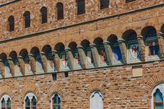 Architectural details of Palazzo Vecchio with coats of arms in the histocial center of Florence, Italy stock images