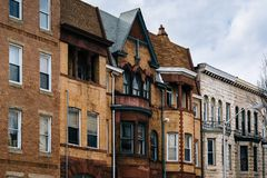 Architectural details of row houses in the Station North Arts and Entertainment District, in Baltimore, Maryland.  stock images