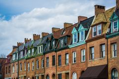 Architectural details of row houses in the Station North Arts and Entertainment District, in Baltimore, Maryland.  stock photos