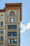 Architectural details on Soho building, Manhattan,. View of facade ornaments framing a Soho building windows. Soho urban architecture, Manhattan, NYC. Nice Stock Image