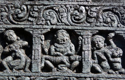 Architectural details of stone carvings in ancient Hindu Temple Stock Photo