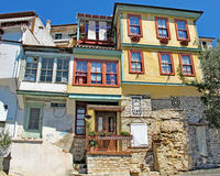 Architectural details of traditional houses with colored windows royalty free stock photos