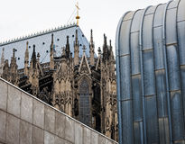 Architectural differences in Cologne. The architectural contrast between the Dome and modern museums in Cologne Royalty Free Stock Images