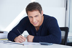 Architectural draftsman working. At his desk in the office on a blueprint royalty free stock images