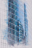 Architectural drawing on the glass of the office building of nearby skyscrapers Stock Image
