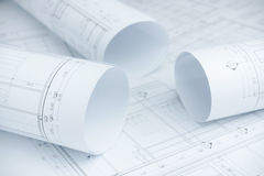 Architectural drawing paper rolls of a dwelling. For construction Royalty Free Stock Images