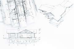 Architectural drawing with rolls of blueprints Royalty Free Stock Photos