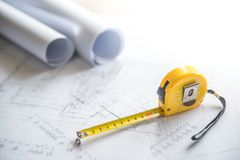 Architectural drawing and tape measure on work table Stock Photography