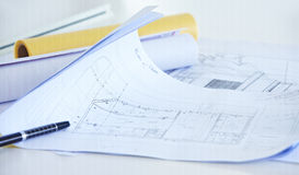 Architectural drawings on desk Stock Photography