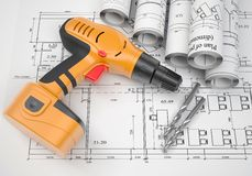Architectural drawings and electric screwdriver Stock Photography