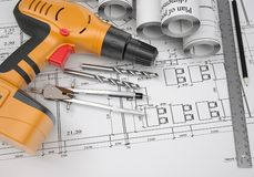 Architectural drawings and electric screwdriver Royalty Free Stock Photo