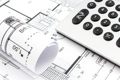 Architectural drawings of a house. With calculator Royalty Free Stock Image