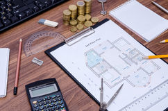 Architectural drawings of the modern house with computer keyboard, calculator, notepad, pen, Stock Photo