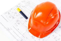 Architectural drawings and orange helmet Stock Photos