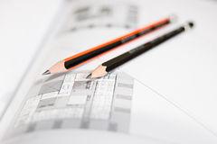 Architectural drawings with pencils. Architectural drawings of a building taken from an architectural magazine with two pencils royalty free stock images