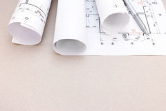Architectural drawings with rolls of blueprints Stock Photography