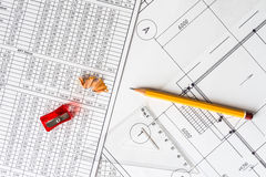 Architectural drawings, a triangle and a sharpener with a pencil Royalty Free Stock Images