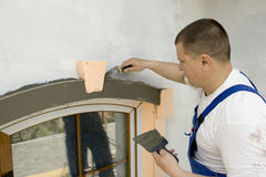 Architectural element. Plasterer inflicts mortar on architectural element Stock Photography