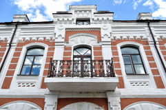 Architectural elements of beautiful old building with stucco molding and balcony in Veliky Novgorod, Russia Stock Photos