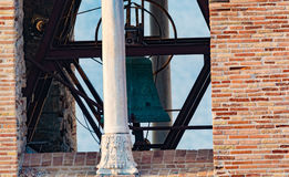 Architectural elements of old bell tower and church Stock Photo