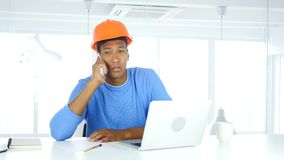 Architectural Engineer Talking on Phone, Attending Call at Work. 4k , high quality Stock Images
