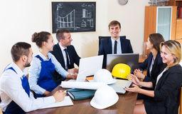 Architectural engineers discussing business project Royalty Free Stock Photo