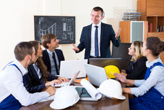 Architectural engineers discussing business project Stock Photo