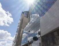 Architectural exterior detail of industrial office building with. Sun and cloud Stock Photography