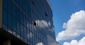 Architectural exterior detail of industrial office building with. Cloud Stock Photography