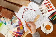 Architectural facade drawing, Two color palette guide, pencils a. Nd ruler.Graphic designer at work stock image