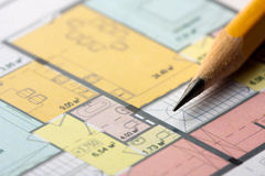 Architectural floor plan. Close-up of pencil on architectural floor plan royalty free stock images